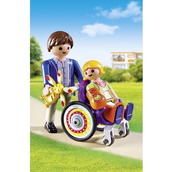 Enfant avec fauteuil roulant et papa Playmobil City Life 6663
